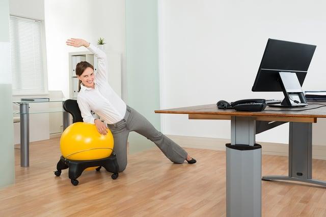 bigstock-Businesswoman-Doing-Fitness-Ex-101942876.jpg