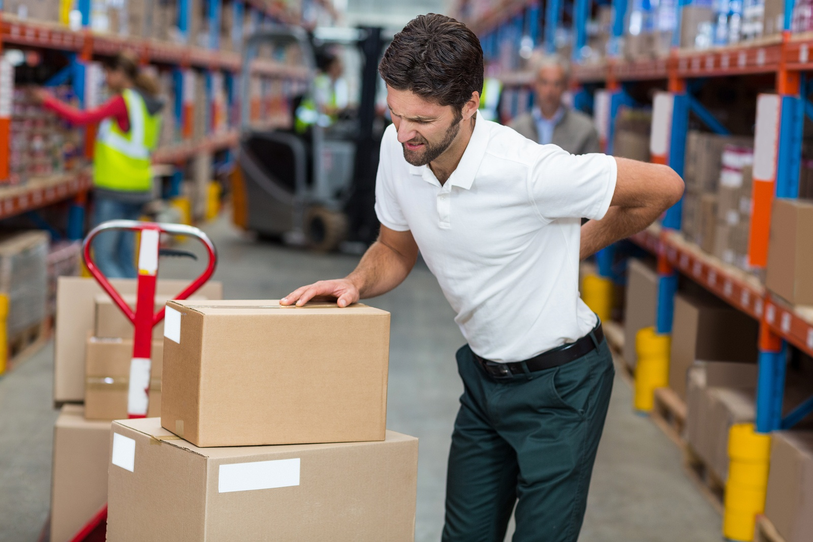 bigstock-Focus-of-worker-having-a-backa-139454861