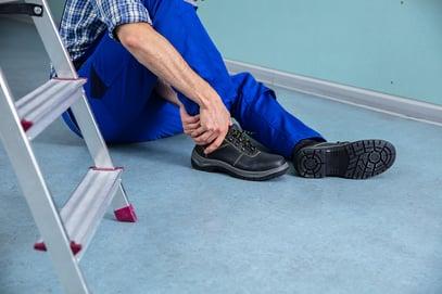 bigstock-Handyman-Touching-His-Injured--254044438