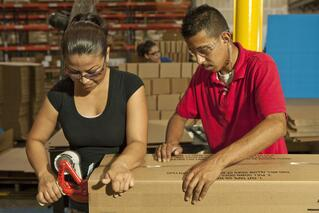 bigstock-Hispanic-workers-taping-box-in-185532358.jpg
