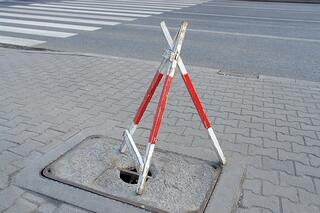 bigstock-Hole-In-Sidewalk-2725544.jpg