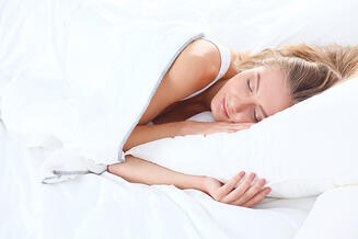 bigstock-Young-sleeping-woman-and-alarm-202862185