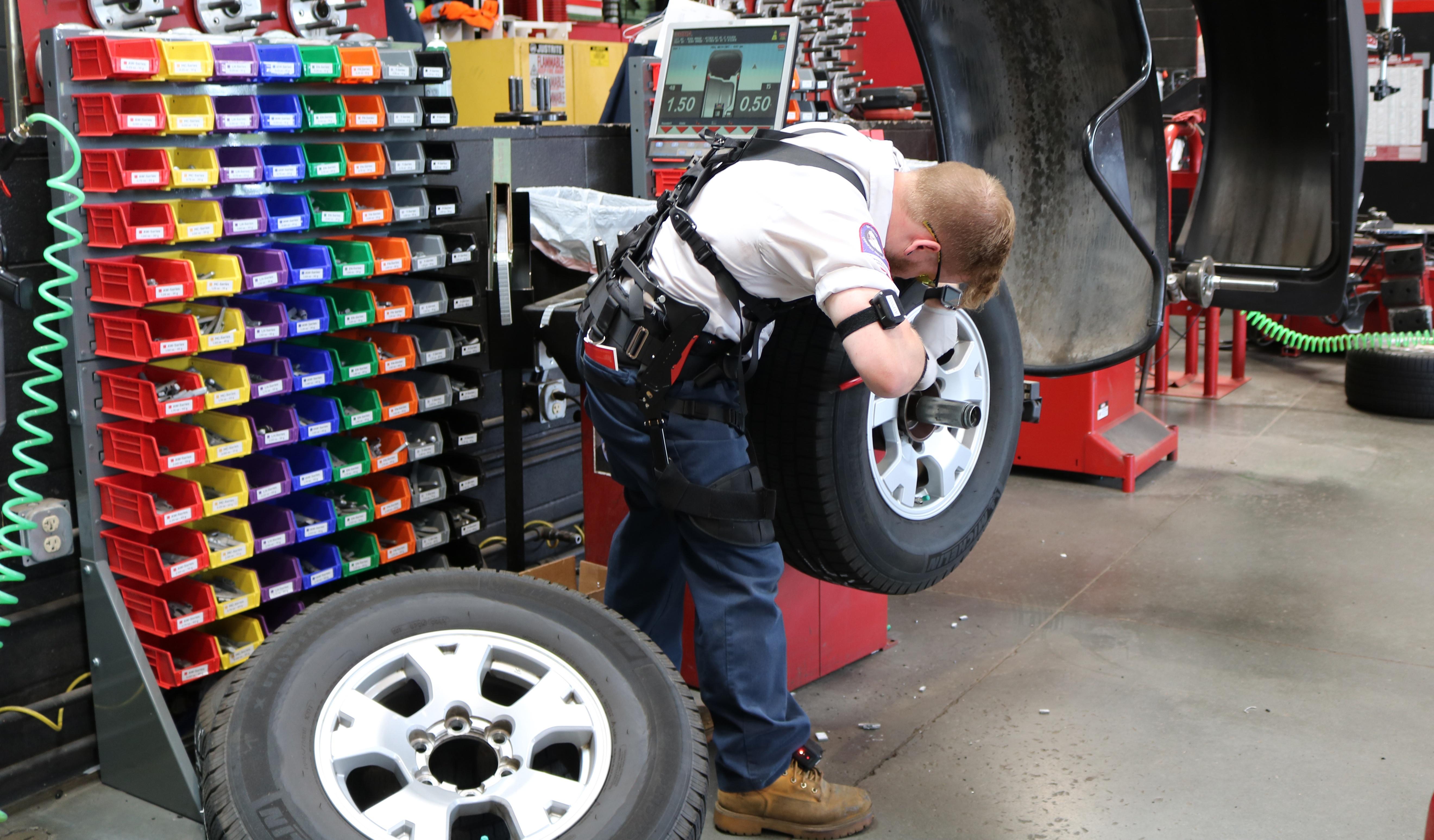 Worker wearing exoskeleton